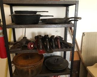 Antique Iron pans and pots.  Old planets and other tools.