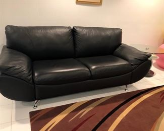 Beautiful contemporary black leather sofa, loveseat & chair with chrome legs