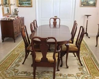 """Dining Room Table, 88"""" L x 42"""" W x 28"""" H with two 12"""" leaves as shown, includes table pads. Dining Room Chairs (8)."""