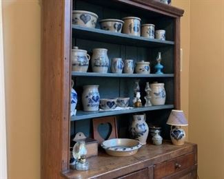 1880's cupboard  shelves in under cabinette   Rowe pottery and oil lamp collection for sale