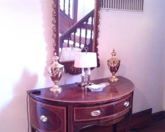 Ornate Chippendale mirror and more in the hall