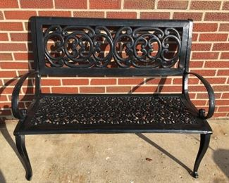 . . . I love this wrought-iron bench -- everybody can find a special spot for this piece -- just in time for spring