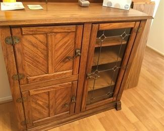 . . . this is an oak server/cabinet made to resemble an old ice chest