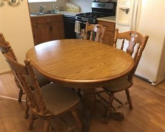 . . . a nice oak table and four chairs -- two leaves come with this fine set