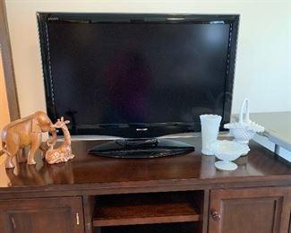 Sharp flat screen TV and TV stand (needs a little TLC)