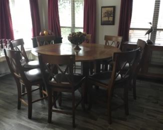 Breakfast table that turned into three different shapes. This is a round table with 8 barstools.  ( table & barstools will not go half price)
