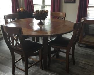 Breakfast table that turned into three different shapes. This is a round table with 4 Barstools. Also has a marble  lazy  Sue in the middle.  ( table & barstools will not go half price)