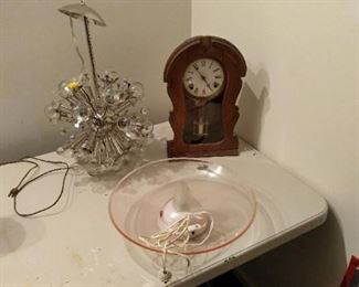 Jonathan Adler sputnik lamp -,  old clock that does work (has the key) .  Vintage glass fish water fountain  (I believe fountain has a small leak)