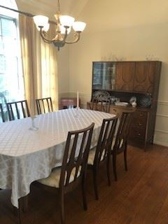 Brasilia by Broyhill Walnut table with matching walnut china cabinet with 6 chairs.  Cabinet is in outstanding condition. Prized and babied by one owner, who regularly dusted and carefully treasured this Danish modern design.