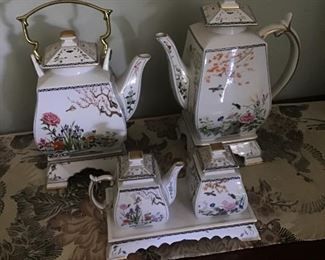 Birds & Flowers  of the Orient Coffee & Tea set. Sugar & Creamer also.  Each of the pieces have their own stand. Matching Clock included  8 pieces  $150