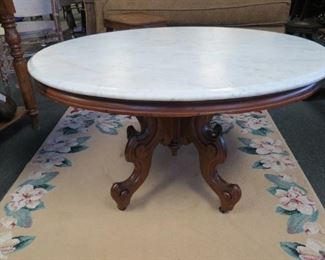 Antique Victorian marble top coffee table.