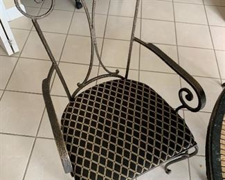 "Kitchen table set with stone top and 4 wrought iron chairs (42"" round) - $500 or best offer."
