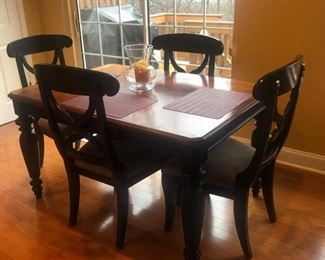 Kitchen table and four chairs. 54 inches long, 38 inches wide with one leaf. Asking $395. Call 908-896-5943 to purchase or with questions