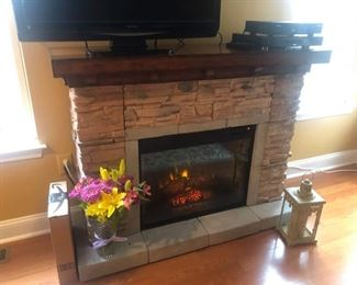 """Like brand new electric fireplace! Throws marvelous warmth! Asking $295. Measures 57"""" long, 43"""" high and 28"""" deep. Call 908-896-5943 to purchase or with questions"""