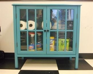 Lot 106 Blue Wooden Cabinet with Glass Pane Doors  Cleaning Products