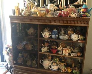 Tea pots and cabinet