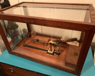 Antique weighing and measuring equipment in case $125