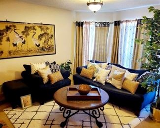 Black Suedelike Couch and chair w/ottoman; Throw Pillows, Wall Art; Rug; Table with inlet design; drapery