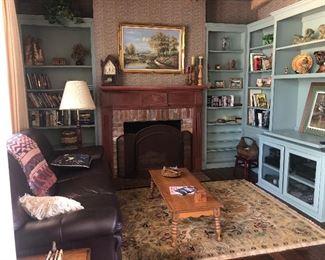 Leather sofa $600 Coffee table $65 Clock on mantle $115 Area Rug $300