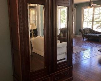 Antique armoire with mirrored doors  $400