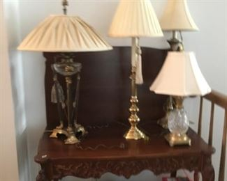 Nice  table,   table has 3 leaves or game table,  lamps, small pineapple crystal front right is signed OLD Waterford with seahorse engraved.