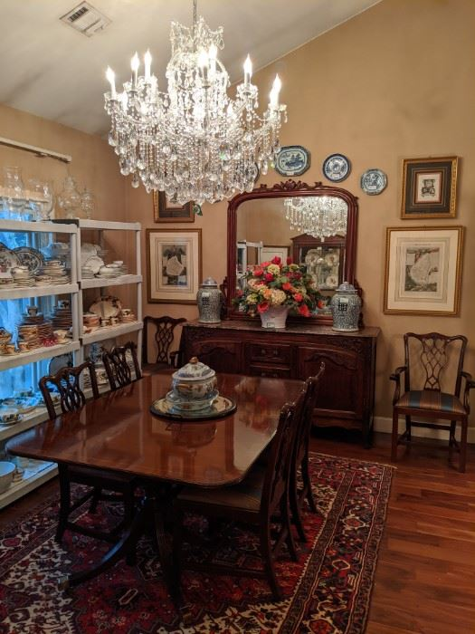 """Baker """"Historic Charleston Reproductions"""" banded mahogany dining table, with two leaves, four side chairs and pair of armchairs.  19th century hand-carved walnut mirror, pair of vintage Asian porcelain jars, vintage hand-woven Persian Heriz, measuring 7' x 10'."""