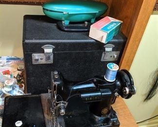 another little sewing machine by singer with case