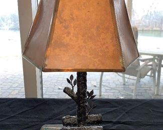 "Handmade in 1935 iron lamp with metal and paper shade. 16"" tall shade does have damage.  $15.00"
