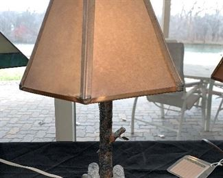 "Handmade in 1935 iron lamp with metal and paper shade. Damage to shade. 16"" tall  2 available at $15.00"