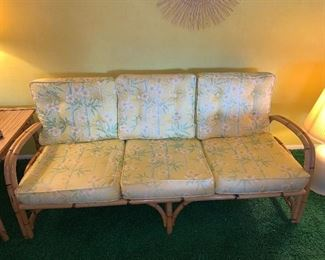 Bamboo framed sofa with cloth cushions. Some wear to cushions  $50.00