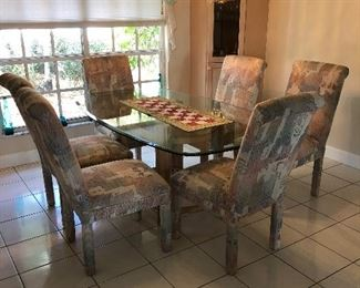 Glass top dining room set with 6 chairs. If you would like a different pattern, you can easily put store bought slip covers at a reasonable price.