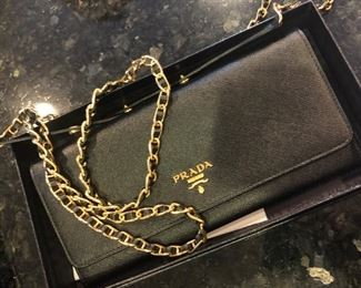 Like new, authentic  Prada wallet / clutch with chain