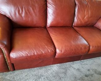 5 Pieces of well cared for leather furniture with nail head trim. Includes sofa, two chairs and two matching ottomans! SMOKE & PET FREE HOME:)