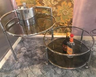 chrome and smokey glass swing out MCM cocktail cart table. Drinking alone has never been sexier:)
