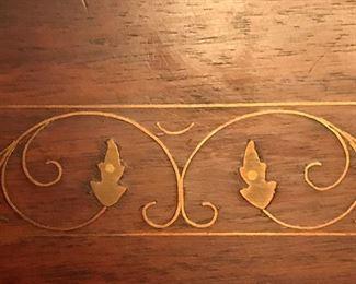 brass inlay on Mid Century wood tea/bar cart