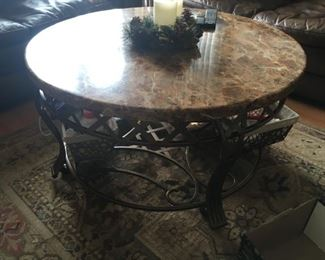 . . . I love this wrought-iron and marble coffee table.