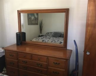 . . . a nice mirrored dresser -- maple, I believe.