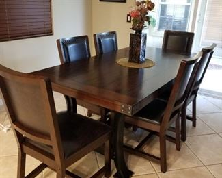 Dark Wood Table with 6 Leather Chairs