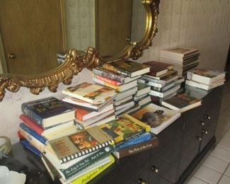 Part of the large collection of books includes MANY Louisiana books and MANY cookbooks. A wonderful collection of books,  part of the proceed to be donated to charity by order of the deceased.