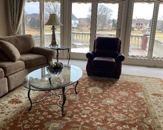 wool rug 13.8x 9.8 $1200.00                                                      oval glass and brass coffee table $195.00
