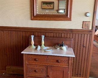 Wash stand with spoon carvings on front