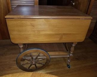 Vintage Side Table with Outer Leafs. Wheels and Lower Tray and Drawer. Contents Included