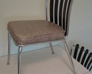 Kitchen: This is one of the six RETRO dinette chairs.  The black back slats are acrylic or plastic. This set is in very good condition!