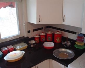 Kitchen:  Colorful vintage PYREX, a red canister set, and colorful storage containers are all displayed.