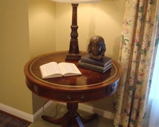 Living Room:  A vintage mahogany drum table with embossed leather top has one drawer and brass cap feet with casters.  The lamp is painted bronze/black and has a small raised brass fleur de lis on it.  The plaster head rests on a group of vintage math books (algebra, calculus, analytical geometry) while a mathematical tables book is laying open.  All of the books are from the 1930's and 1940's--all fun gifts for the math whiz in your family .