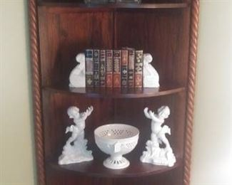 """Living Room:  These often-difficult-to-find corner cabinets are great, as people love the fact that they don't take up much room!  This one has carved braid wood trim on the left and right sides and four shelves.  It measures 35"""" wide x 26"""" deep x 77"""" tall.  The sets of  bookends, book, a faux set of books, ceramic cherubs, and ceramic bowl are also for sale."""