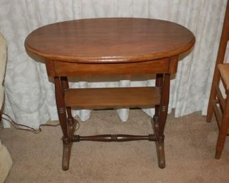 """Oval side table, 30"""" W x 18"""" D x 27"""" H"""