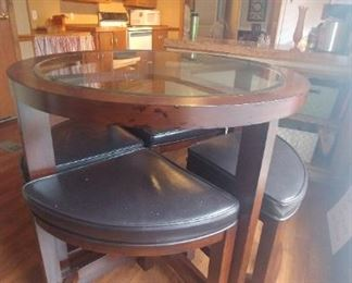 "Kitchen dinette counter height table with four stools that nest under 36"" round table."