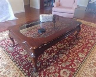 9x12 rug in excellent condition Cherry finish coffee table with Glass top.
