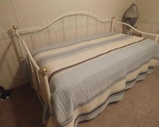 Nice metal  and brass daybed with a trundle bed and mattresses.